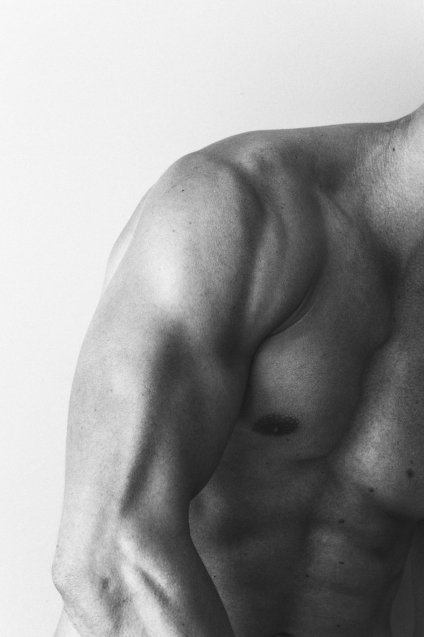 shirtless, muscular build, studio shot, men, one person, human skin, white background, strength, exercising, lifestyles, human body, the human body, close-up, human back, real people, human body part, indoors, abdomen, masculinity, one man only, sportsman, young adult, day, people