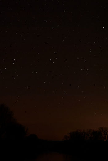 I need a wider lens (and no light pollution) Clear Sky Light Pollution Night Shot River View Astronomy Beauty In Nature Galaxy Nature Night Night Sky Nightscape No People Outdoors River At Night Scenics Silence Silence Of Nature Silhouette Sky Starry Tranquil Scene Tranquility Tree Tree Line