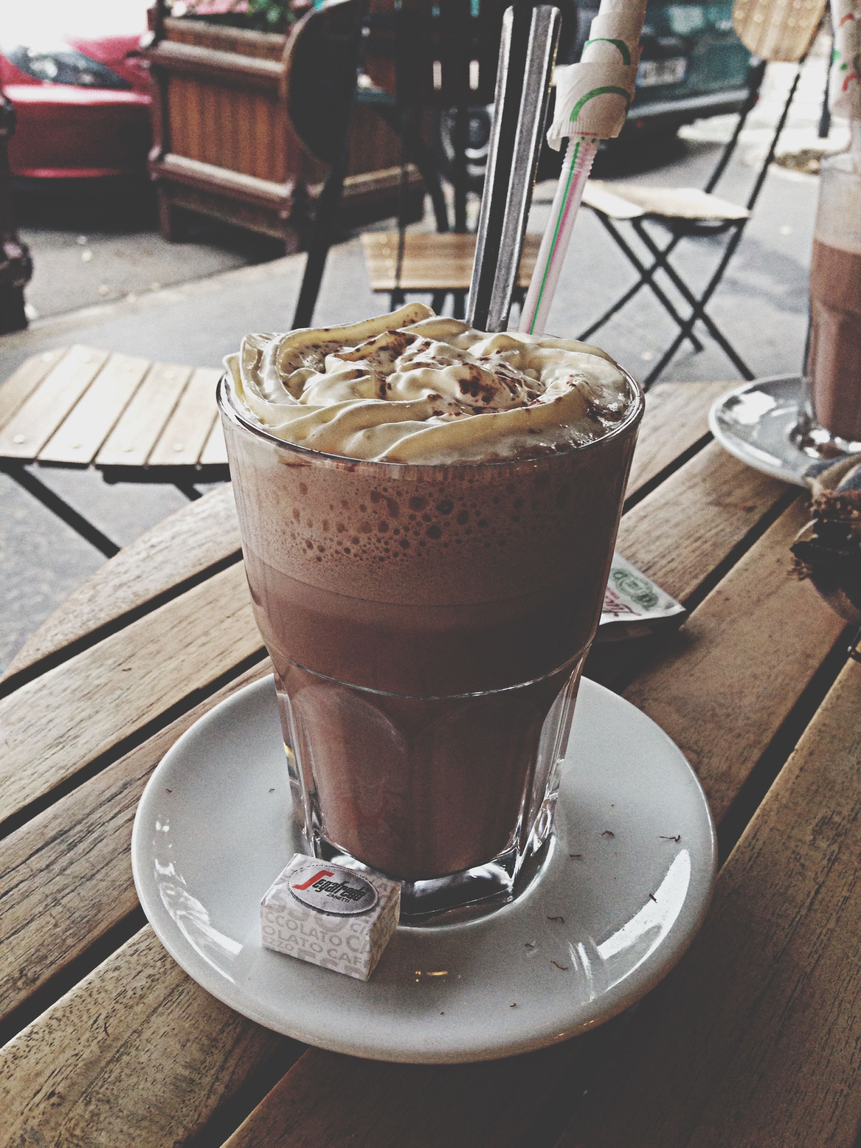 food and drink, drink, table, freshness, refreshment, drinking glass, indoors, close-up, still life, restaurant, food, spoon, sweet food, indulgence, serving size, unhealthy eating, focus on foreground, coffee - drink, cafe, frothy drink