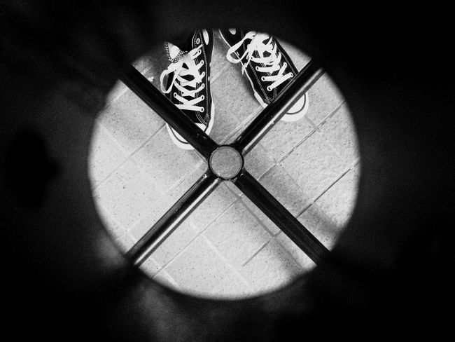 Looking Looking At Things Looking Through Looking Down Through The Hole IPhoneography Black & White Blackandwhite Circle Frame Circles In Circles Shape legs under the table