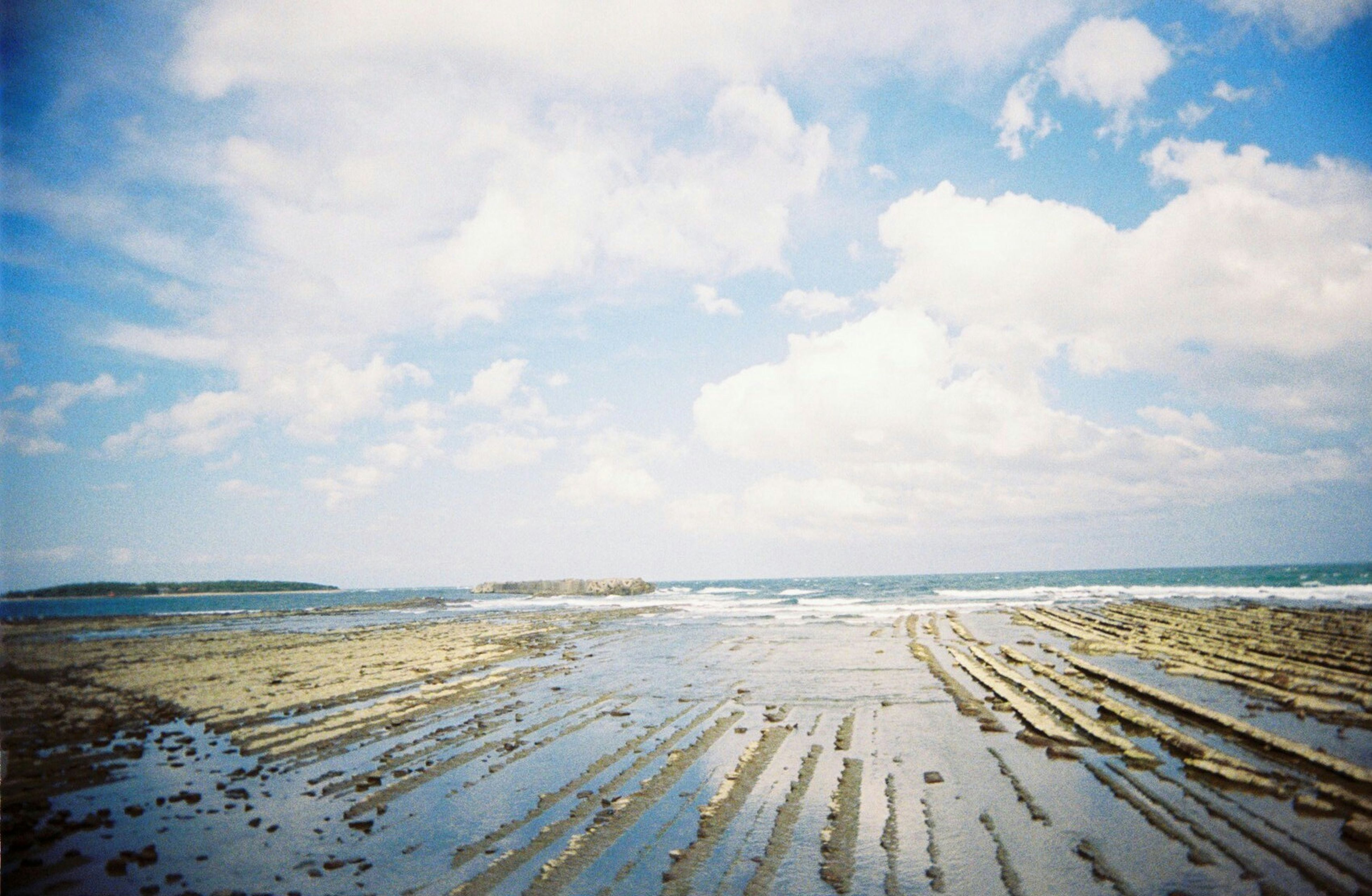 sea, beach, sky, water, horizon over water, tranquility, tranquil scene, shore, sand, scenics, cloud - sky, beauty in nature, nature, cloudy, cloud, idyllic, coastline, day, outdoors, remote