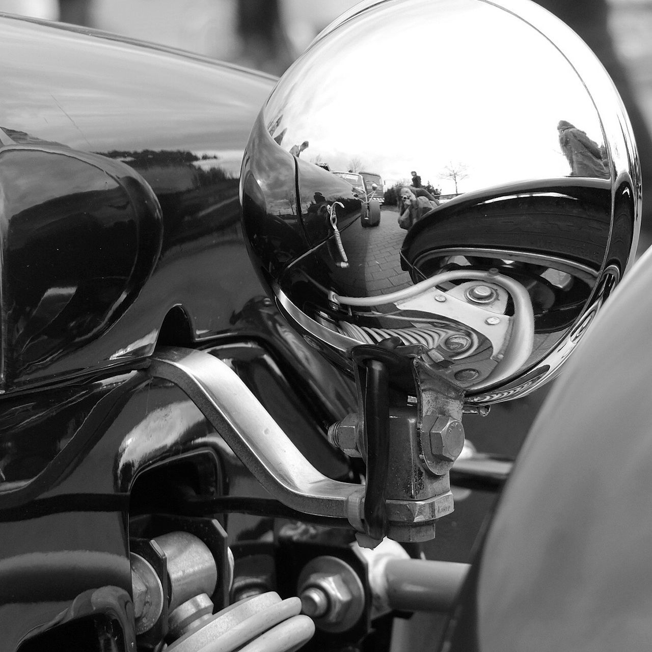 motorcycle, mode of transport, transportation, reflection, close-up, land vehicle, helmet, side-view mirror, no people, old-fashioned, outdoors, day, headwear, scooter