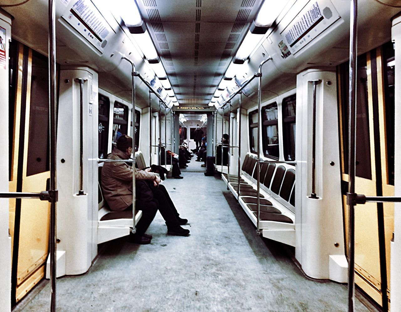 train - vehicle, public transportation, transportation, rail transportation, passenger train, men, mode of transport, real people, vehicle seat, travel, full length, subway train, indoors, sitting, women, one person, day, adult, people
