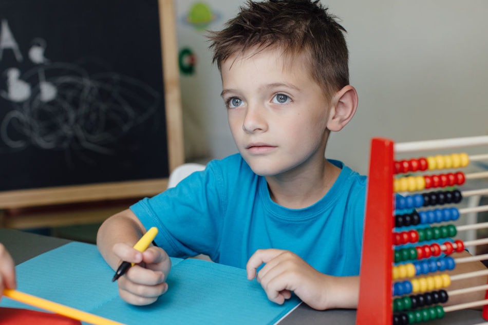 Thinking schoolboy working on a math project at home Abacus Assignment Boy Caucasian Child Counting Critical Home Homeschooling Homework Independent  Kid Learn Learning Mathematics Maths Project Room School Schoolboy Schoolchild Solitary Student Thinking Young
