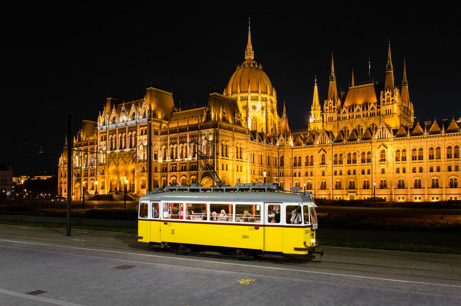Hungarian Parlament & the old tram Architecture Budapest Cityscape Hungary Night Old Tram Parlament Parlament Budapest Budapeste Hungary Hungria Gold Parlament Of Hungary State Building Tram Yellow