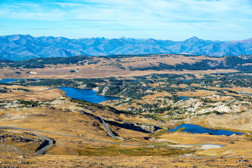 View of lakes and mountains in the Shoshone National Forest in the Beartooth Mountains in Montana and Wyoming Alpine Bear Montana Scenic Shoshone Travel Tundra USA Wyoming Beartooth Destination Forest Highway Landscape Mountain Mountain Range Mountains National Forest Overlook Peaks Plateau Redlodge Tooth Valley Wilderness