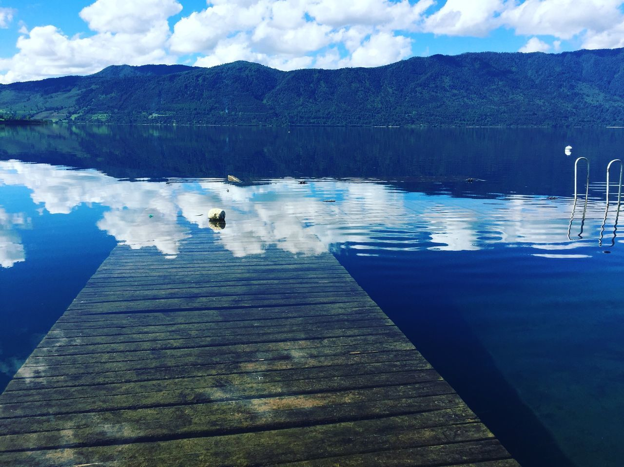 water, reflection, tranquility, tranquil scene, sky, nature, beauty in nature, scenics, lake, day, no people, outdoors, blue