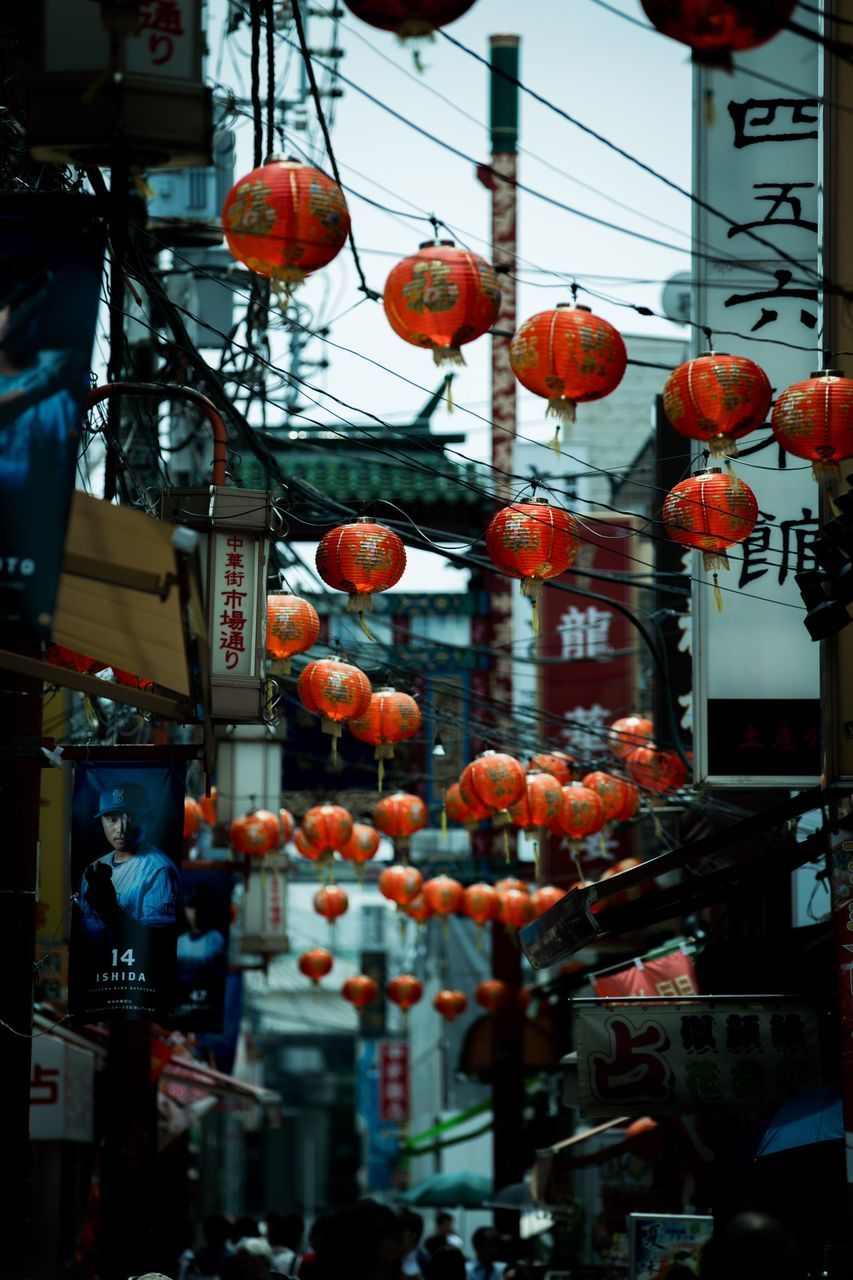 hanging, chinese lantern, lantern, chinese lantern festival, chinese new year, built structure, celebration, low angle view, paper lantern, architecture, outdoors, day, no people, building exterior, sky