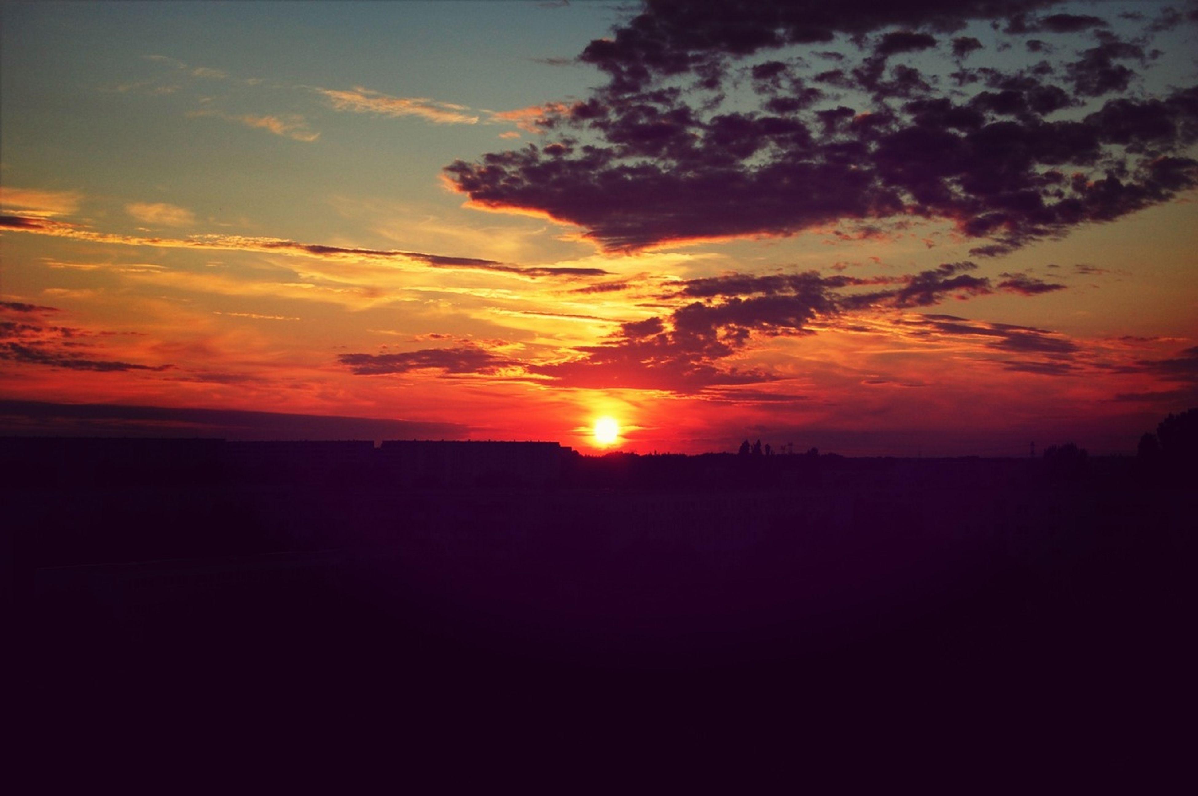 sunset, silhouette, orange color, sun, scenics, tranquil scene, sky, beauty in nature, tranquility, idyllic, nature, cloud - sky, landscape, dark, sunlight, dramatic sky, cloud, outline, moody sky, outdoors