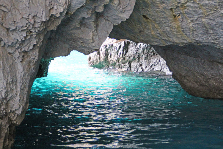blue Grotto Beauty In Nature Blue Blue Grotto Blue Water Cliff Eroded Geology Grotto Idyllic Nature Nature Photography Nature_collection Non Urban Scene Non-urban Scene Outdoors Physical Geography Rippled Rock Rock - Object Rock Formation Scenics Tourism Travel Destinations Water