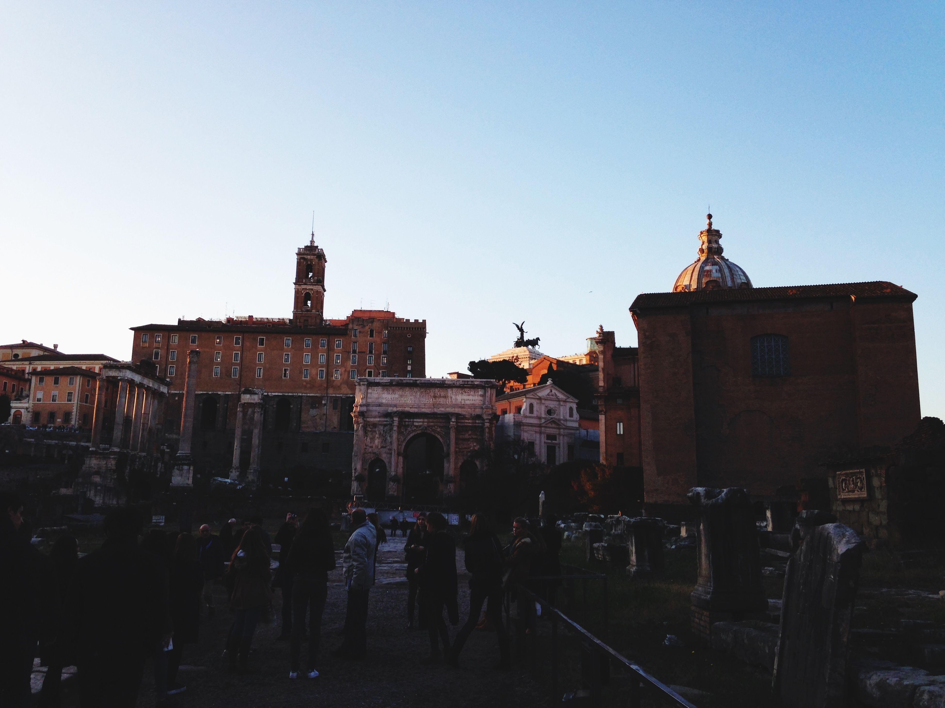 clear sky, architecture, built structure, building exterior, copy space, large group of people, men, person, history, walking, lifestyles, travel destinations, leisure activity, street, outdoors, travel, city, group of people, city life