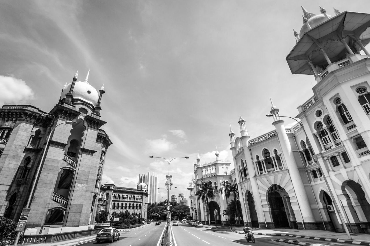 The historic Kuala Lumpur Railway Station and the Railway Administration Building Architecture Black And White Building Exterior City City Street Day Historical Historical Buildings Iconic Landmark Islamic Architecture Kuala Lumpur Kuala Lumpur Railway Station Monochrome Photography Mughal Architecture Old Kuala Lumpur Road Sky Street Street Photography Train Station