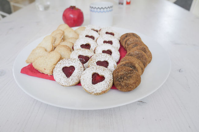 collection of heart shaped biscuits or cookies served at home on a white plate Baked Celebration Christmas Close-up Cookie Day Food Food And Drink Freshness Gingerbread Cookie Holiday - Event Indoors  Indulgence Meal No People Plate Pomegranate Ready-to-eat Red Sweet Food Unhealthy Eating