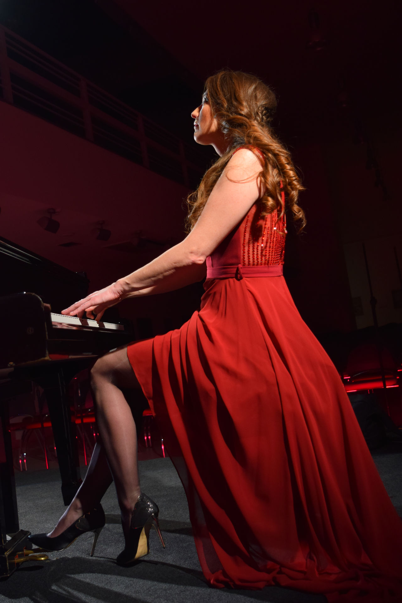One Woman Only Beautiful Woman Glamour Elégance Arts Culture And Entertainment Piano Moments Performing Arts Event Classical Concert Red Dress Dress Concert Photography Evening Gown Red Piano Player Grand Piano Piano Concert Night Women Around The World