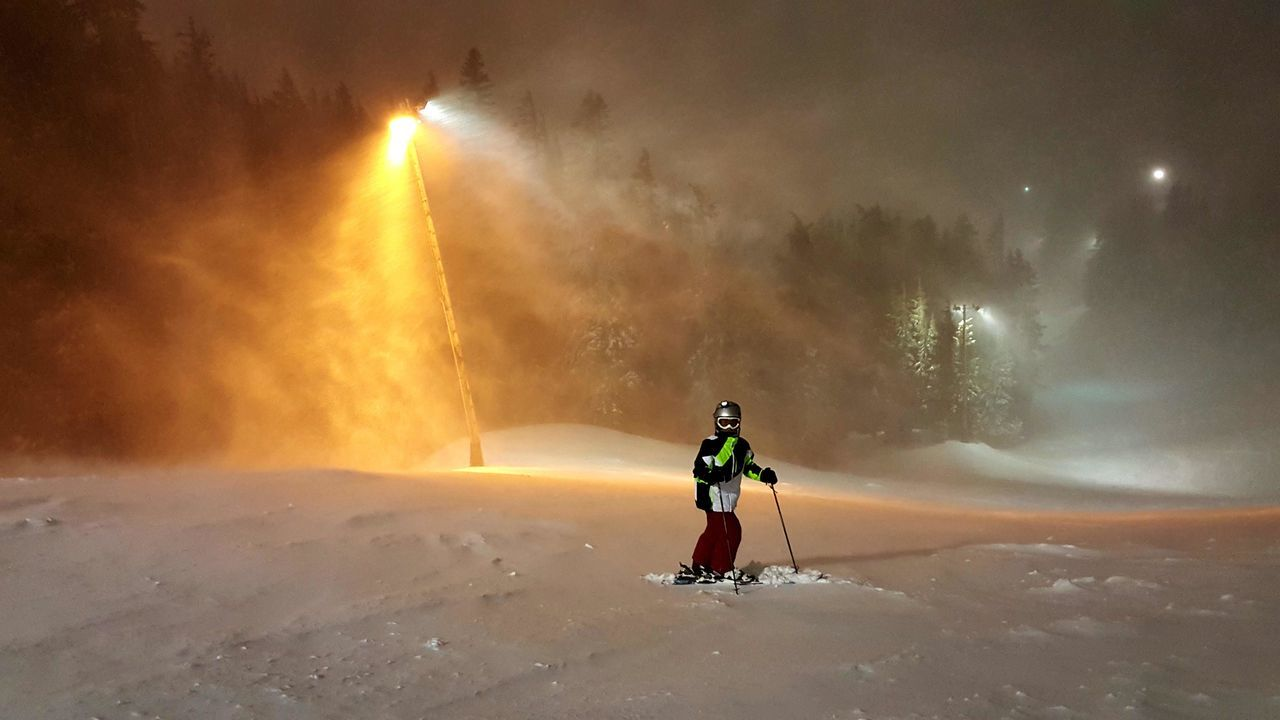 full length, real people, rear view, one person, leisure activity, motion, winter, nature, lifestyles, outdoors, beauty in nature, adventure, snow, sky, men, scenics, water, cold temperature, spraying, day, warm clothing, people
