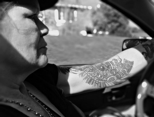 Tattoo Life Columbus Ohio. I got my first tattoo at 12 and almost 50 years later Im still going strong. Tattooed Tattoolife Black And White Photography Shadow Shades And Shadows Car Ride  Female Model Driving In My Car