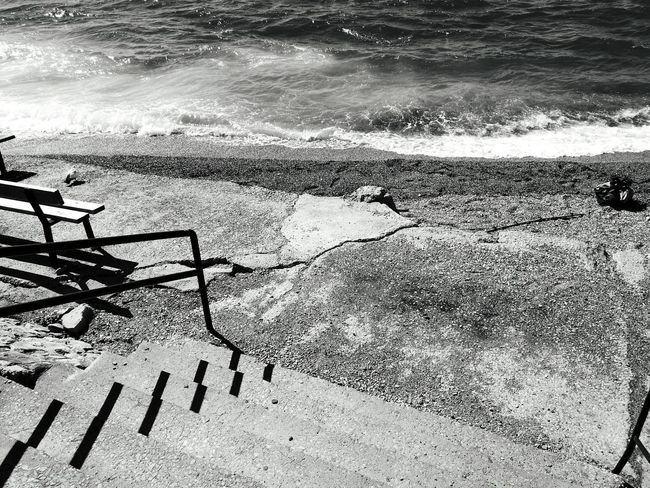 Monochrome Photography Blackandwhite Beach Sea Water Scenics Outdoors No People Black And White Tranquility Shore Wave Loneliness Tranquil Scene Day Stairs To Beach Stairs Platform