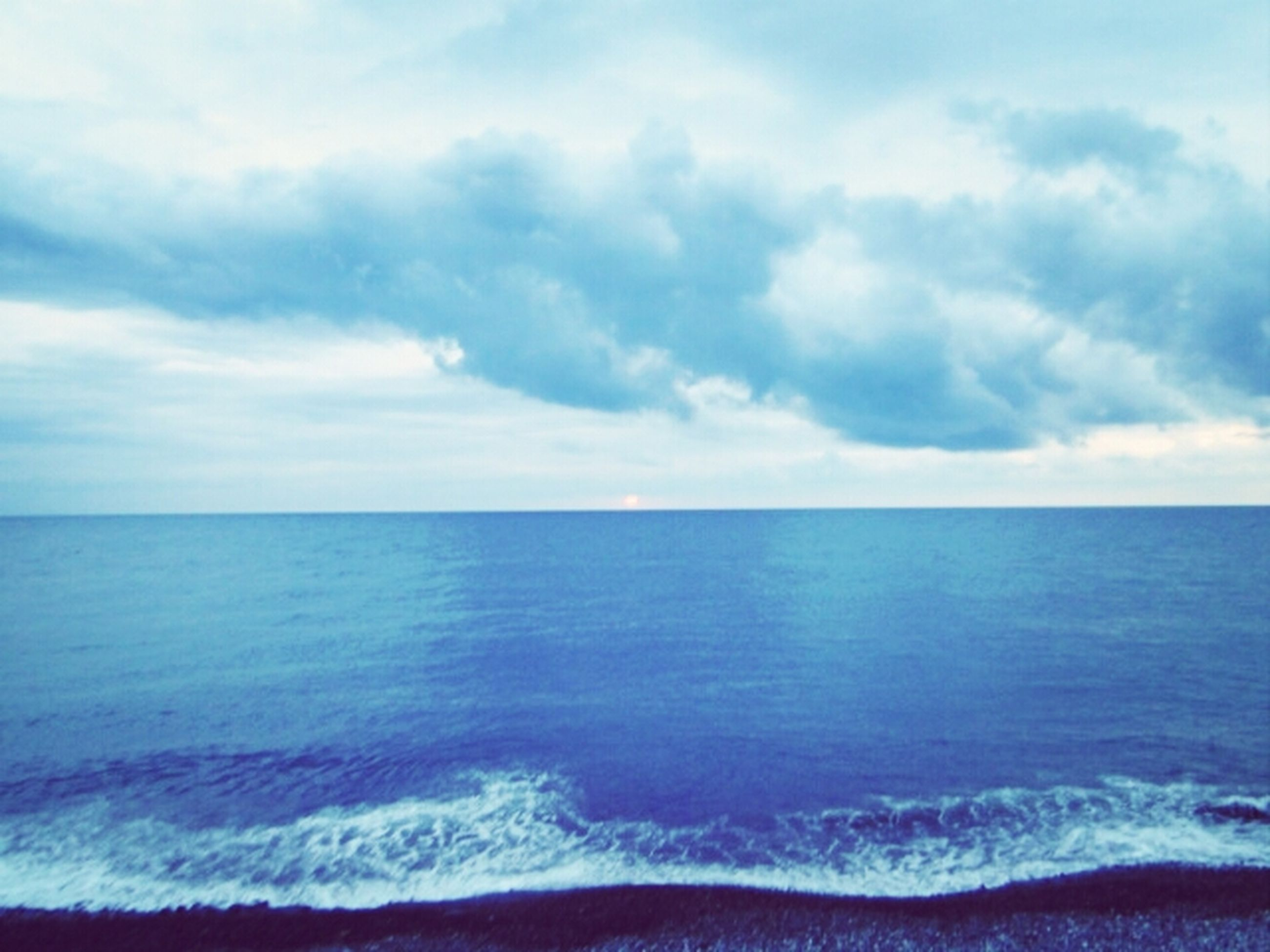 sea, horizon over water, water, sky, scenics, tranquil scene, beauty in nature, tranquility, cloud - sky, nature, cloudy, blue, idyllic, cloud, seascape, wave, beach, waterfront, outdoors, rippled
