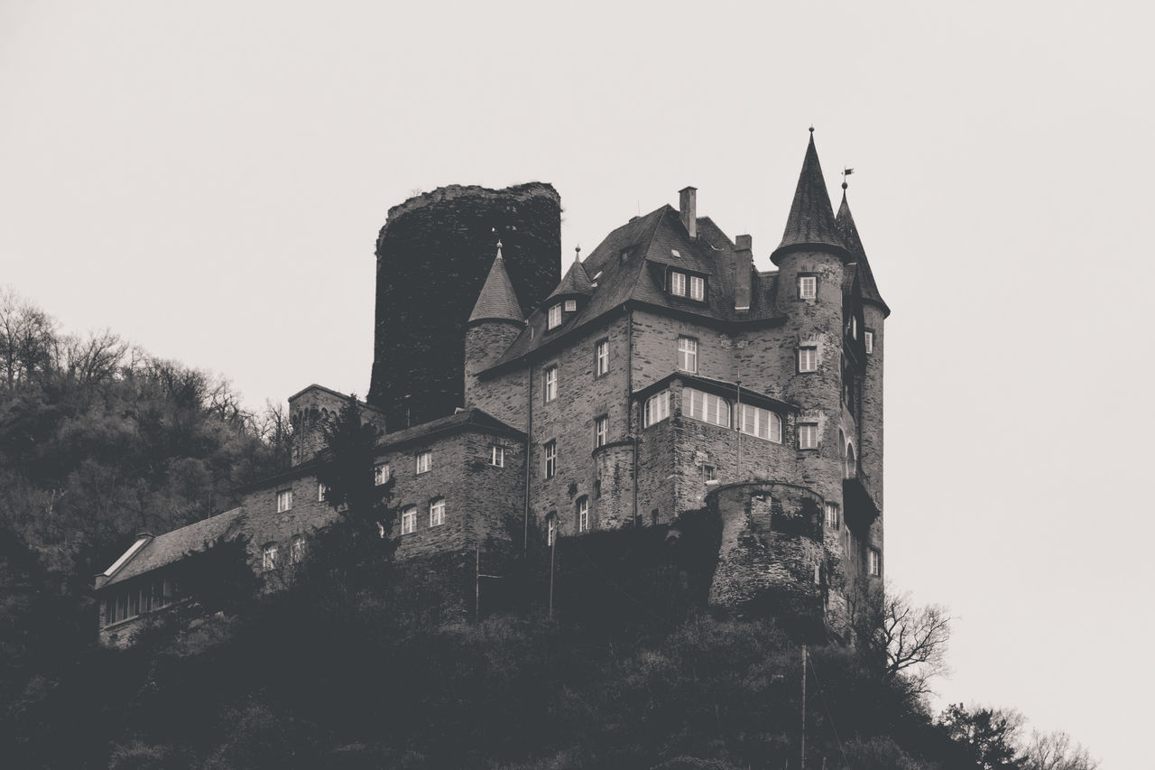 "This is the ""Burg Katz"" (""castle cat"") in St. Goarshausen (Germany). I like its small pointy towers and its location at the hillside. Unfortunately, this castle cannot be entered by tourists. Architecture Black And White Building Building Exterior Built Structure Burg Burg Katz Castle Château Clear Sky Day Fortress Hillside Historical Building Historical Sights History Manor House Mountainside Old Outdoors Slope Stately Home Stronghold The Past Towers"