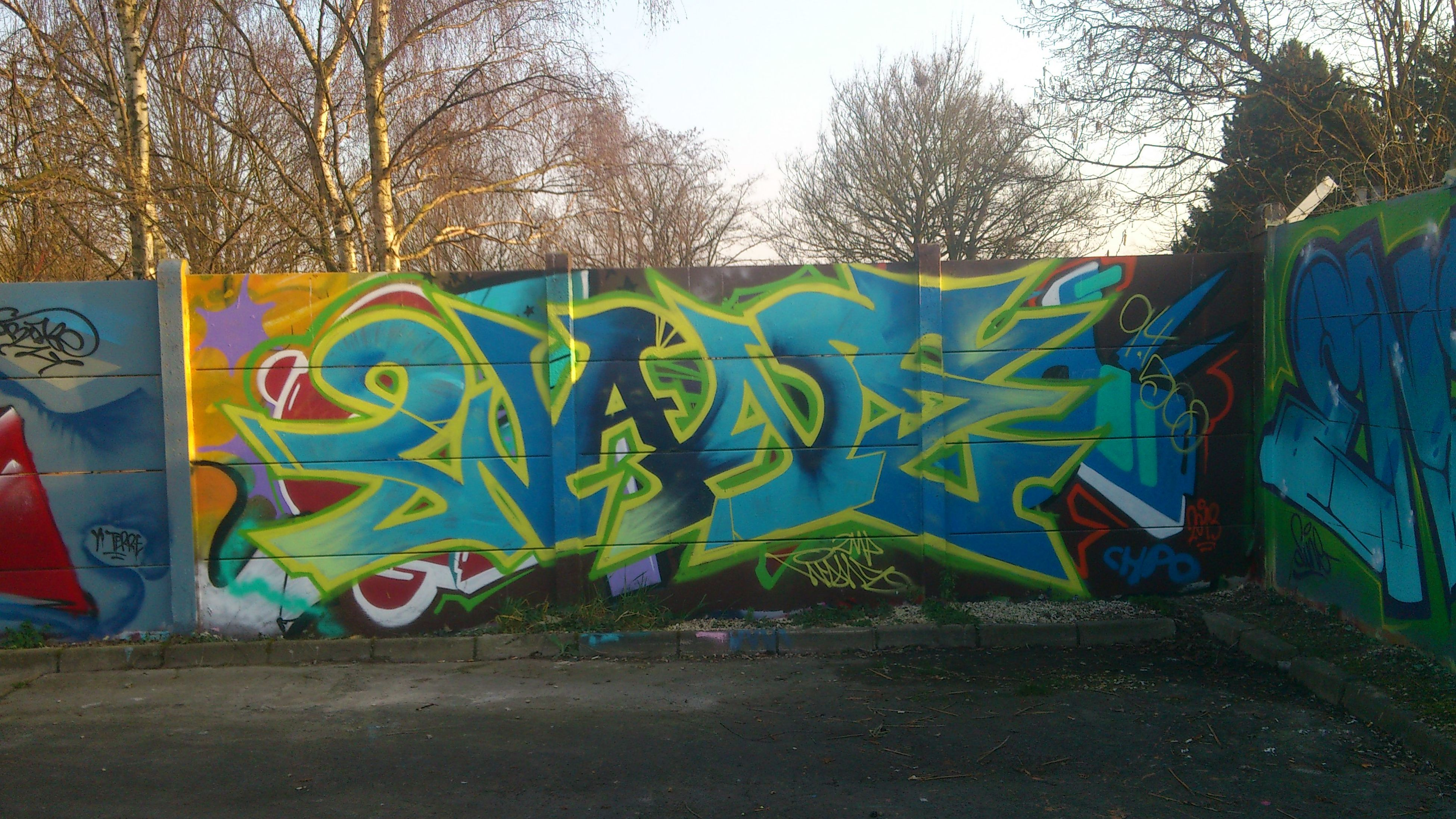 graffiti, art, creativity, art and craft, text, wall - building feature, street art, multi colored, built structure, architecture, western script, tree, day, wall, outdoors, communication, no people, vandalism, building exterior, animal representation