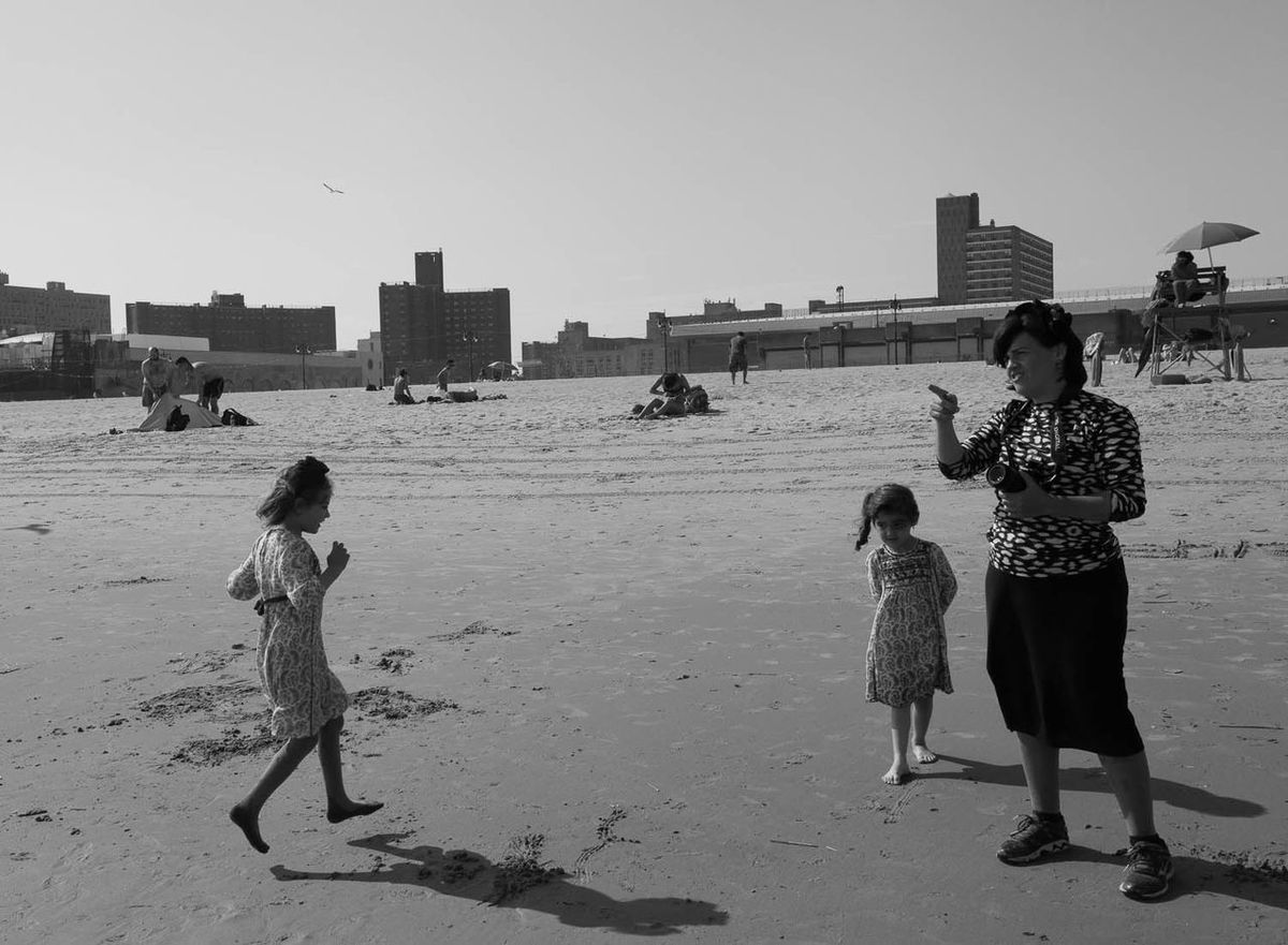 family enjoying the beach at Coney Island Adult Archival Beach Childhood Children Coney Island / Brooklyn NY Day Family Full Length Jewish Nature Outdoors People Sand Sky Young Adult