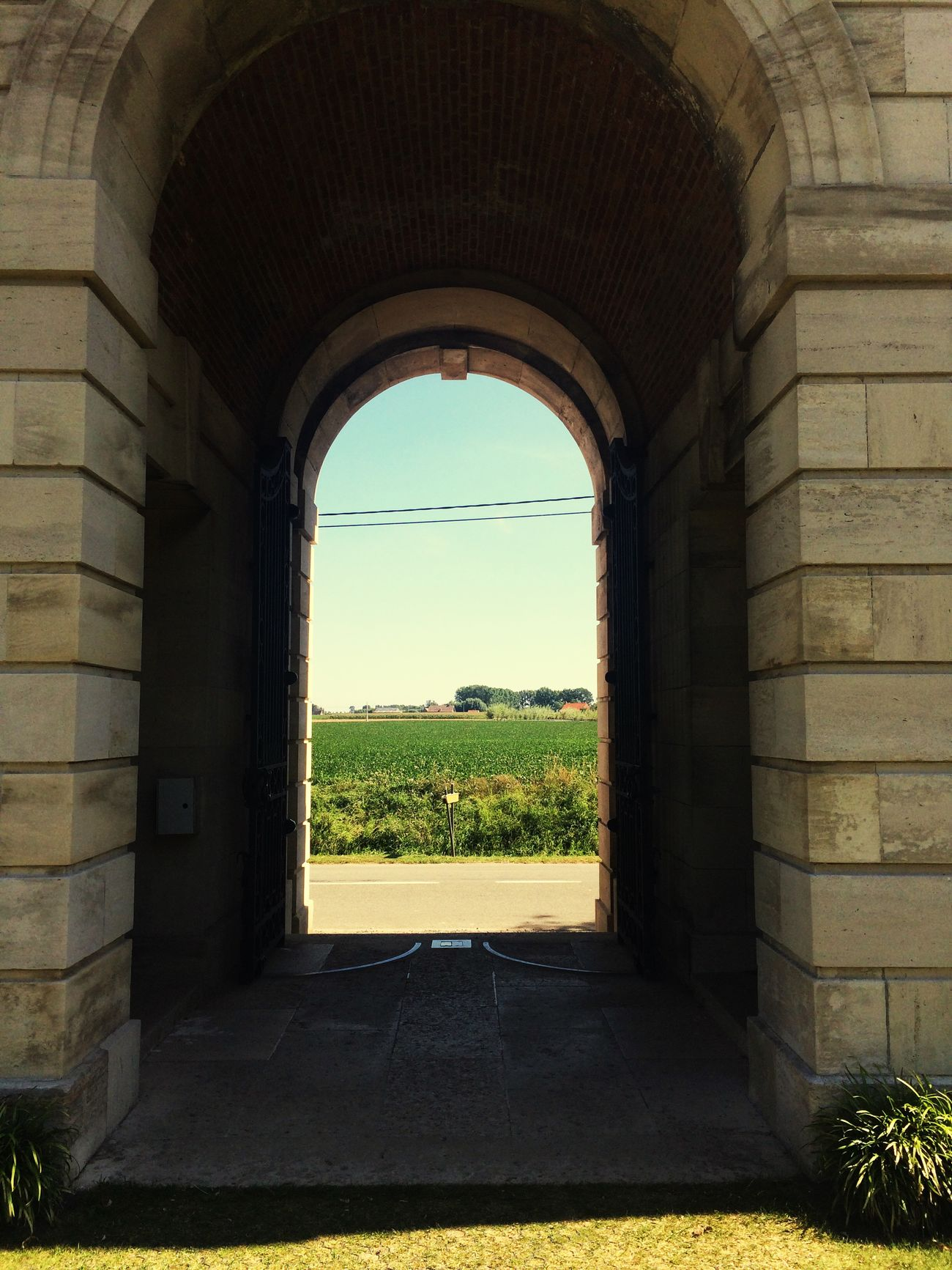Arch with a view in Belgian war cemetery Window