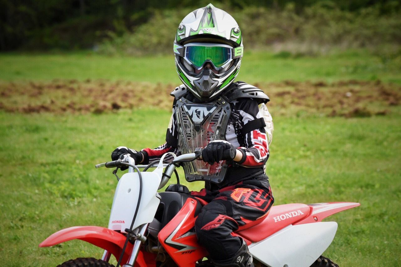 The Great Outdoors - 2017 EyeEm Awards Sport Headwear Grass Sports Helmet Helmet Field Protection Outdoors Day Competition Men Real People Sports Clothing Extreme Sports Challenge Competitive Sport Sports Race Professional Sport Motorsport Sportsman Childhood Memories Youth Culture Youth Of Today Dirtbike