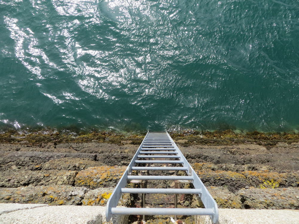 Beauty In Nature Channel Islands Diminishing Perspective Down Jersey Ladder Ladder To Water No People Sea Sunshine Tranquil Scene