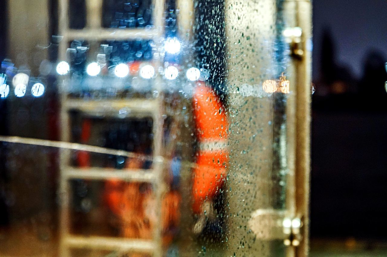 Rainy Nights Close-up Focus On Foreground No People City Indoors  Illuminated Water Day Rescue Ring Harbour View Nightphotography Night Lights Bokeh Photography Bokehlicious RainDrop Rainy Night Rain On Glass Rain On Window Rainy Weather Stormy Weather Wet Weather Wet Window Reflection Shinetrough