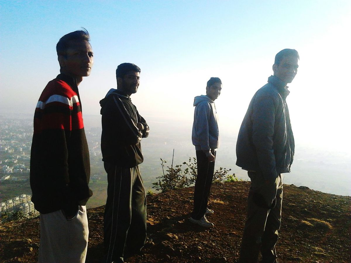 My friends looking at me n i just clicked picture of them at sunrise on top of mountain Pandavleni Nashikisbeautiful Sunlight Nashik