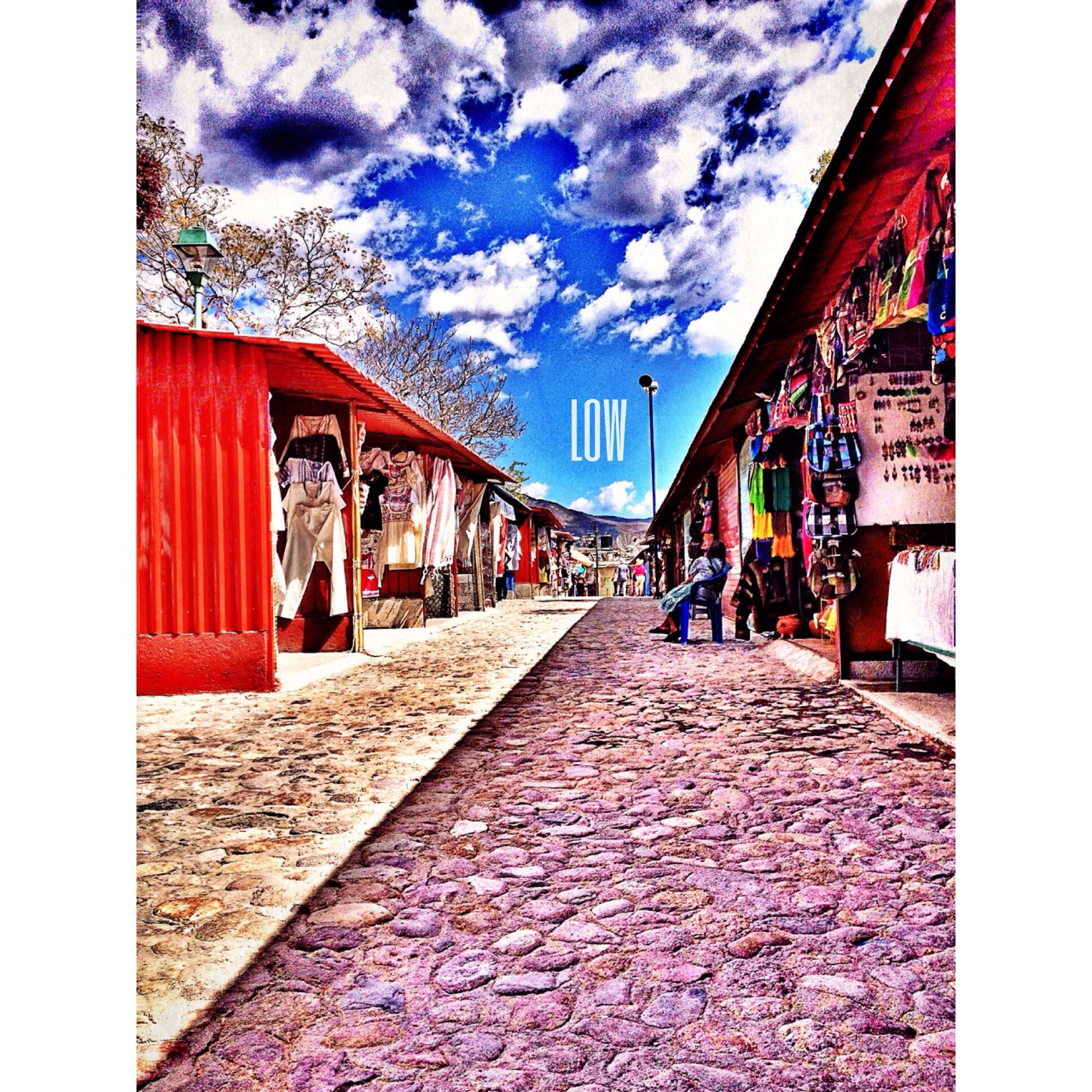 architecture, built structure, building exterior, sky, the way forward, cloud - sky, transfer print, house, cobblestone, cloud, diminishing perspective, walkway, residential structure, street, auto post production filter, footpath, day, empty, cloudy, pathway