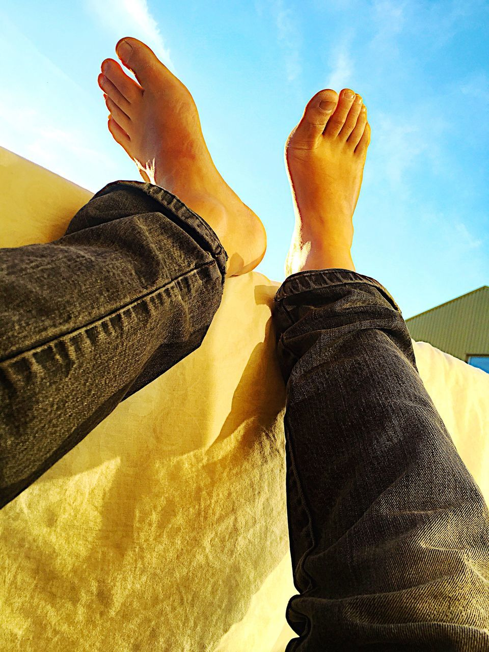 human leg, low section, human foot, personal perspective, one person, real people, human body part, jeans, barefoot, day, sunlight, outdoors, women, lifestyles, men, relaxation, sky, close-up, people