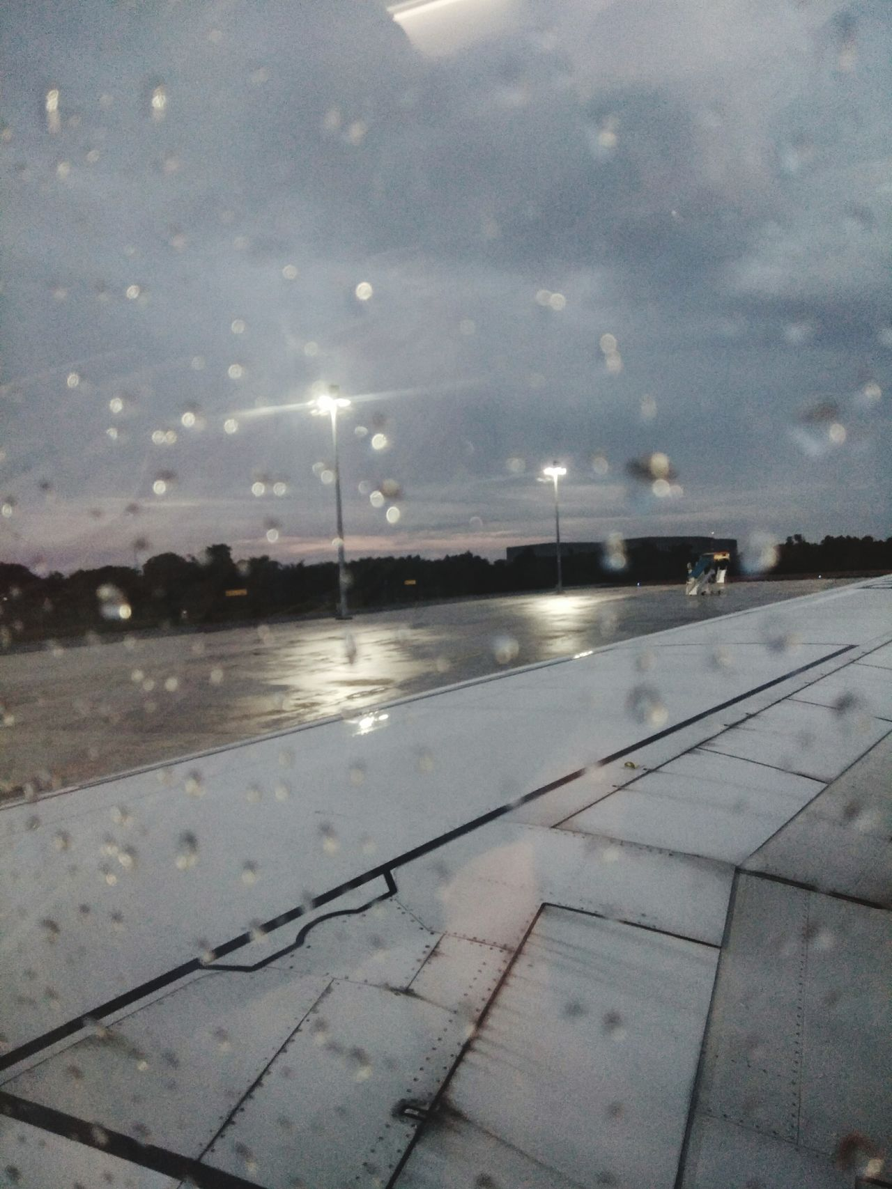 Weather Night Outdoors Sky Reflection Window Sunset Delay Flight Airplane Window Wing No People