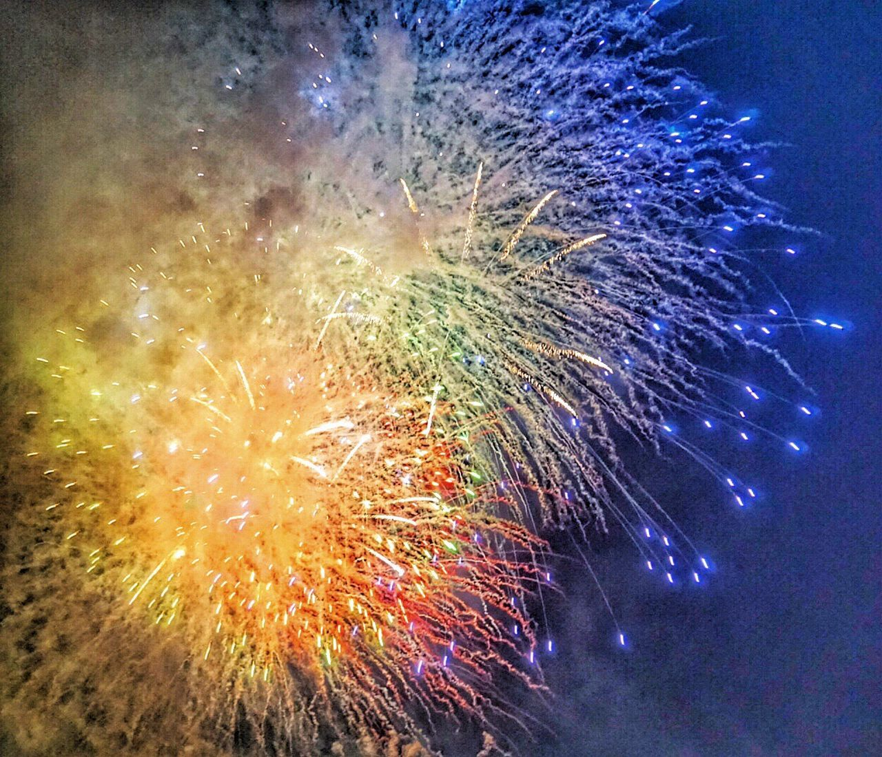 firework display, celebration, exploding, night, firework - man made object, long exposure, arts culture and entertainment, low angle view, event, multi colored, blurred motion, illuminated, firework, motion, sky, awe, no people, outdoors