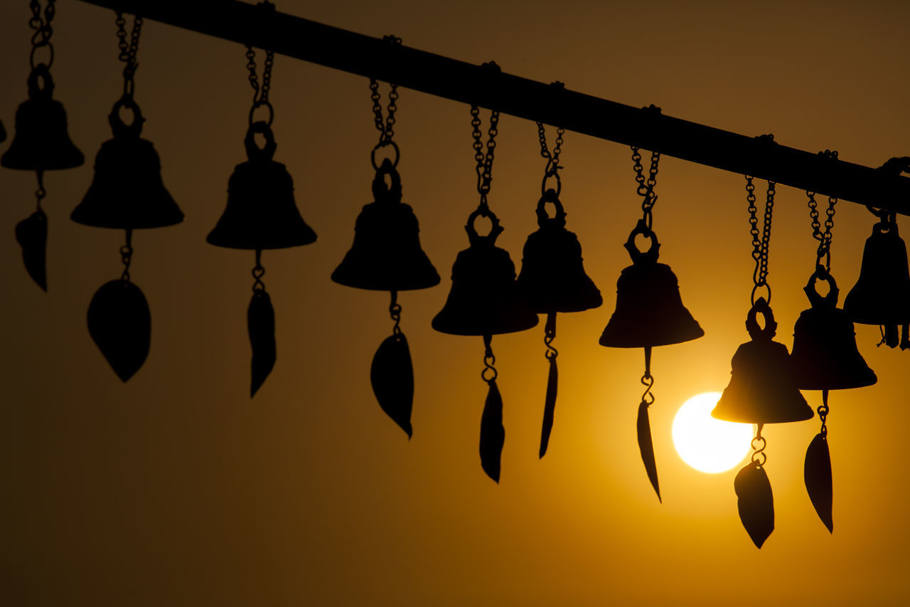 Silhouette of Tibetan wind chimes with the sunset. ASIA Bell Evening Sky Hanging Illuminated Kathmandu Nepal Silhouette Sun Sunset Wind Chime