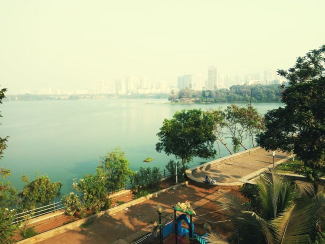 City Skyscraper Cityscape Urban Skyline Architecture Tree Downtown District Nature Outdoors City Life Mumbai MumbaiDiaries Mobile Photography Mumbaiphotography Powai Lake View Powai Lake Powai Garden Mumbai Lakeview Tree_collection  Tree And Sky Shadows And Sunlight Peaceful View The Great Outdoors - 2017 EyeEm Awards The Photojournalist - 2017 EyeEm Awards Live For The Story The Street Photographer - 2017 EyeEm Awards