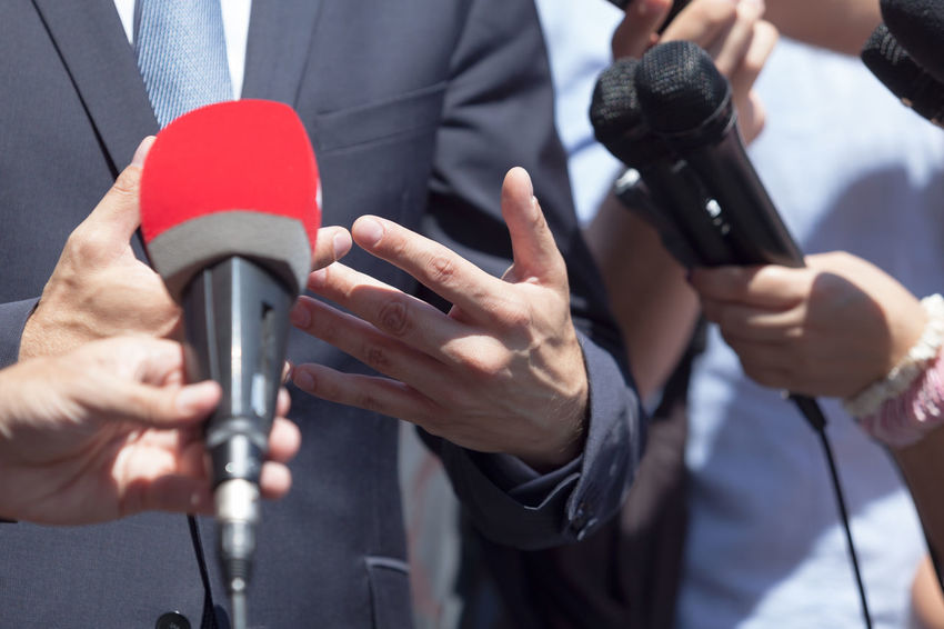 Media or press interview Journalist PR Press Reporting Answering Campaign Speech Communication Human Hand Information Journalism Media Media Interview Microphone News News Conference Occupation People Public Relations Report Reporter