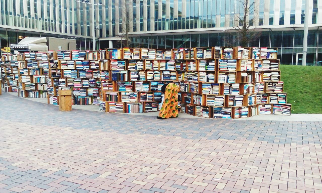 large group of objects, abundance, day, arrangement, choice, book, library, architecture, built structure, building exterior, outdoors, bookshelf, no people, city