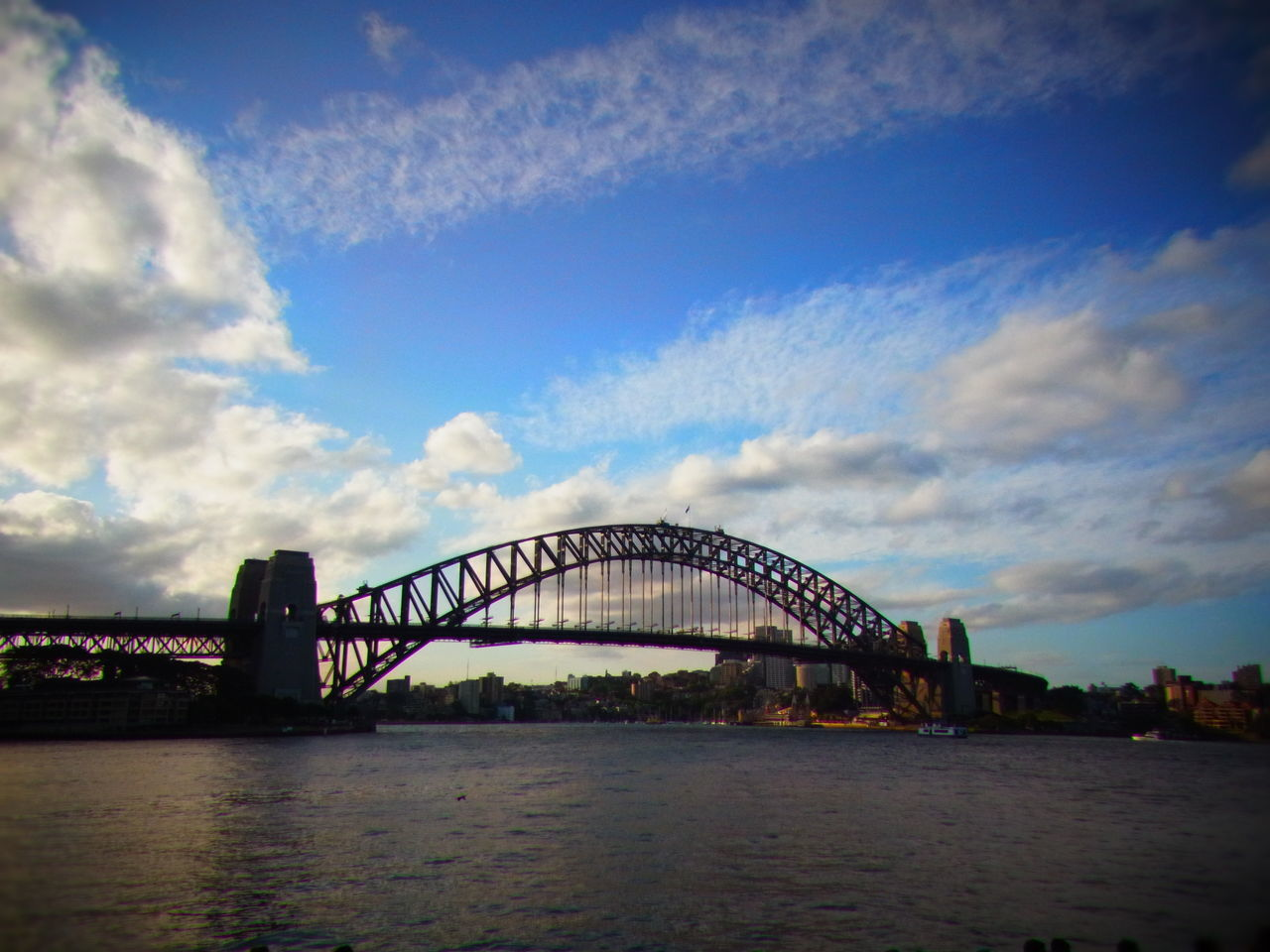 bridge - man made structure, connection, sky, architecture, built structure, river, cloud - sky, water, transportation, travel destinations, no people, outdoors, city, day, nature