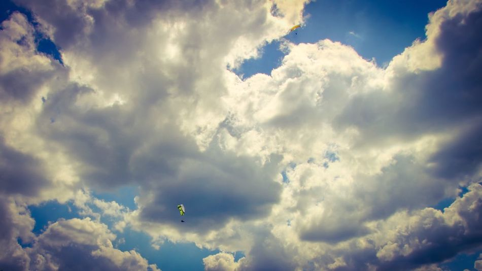 Cloud - Sky Sky Low Angle View Cloudscape Beauty In Nature Scenics Nature Adventure Day Mid-air Outdoors Blue No People Flying Extreme Sports Parachute Paragliding
