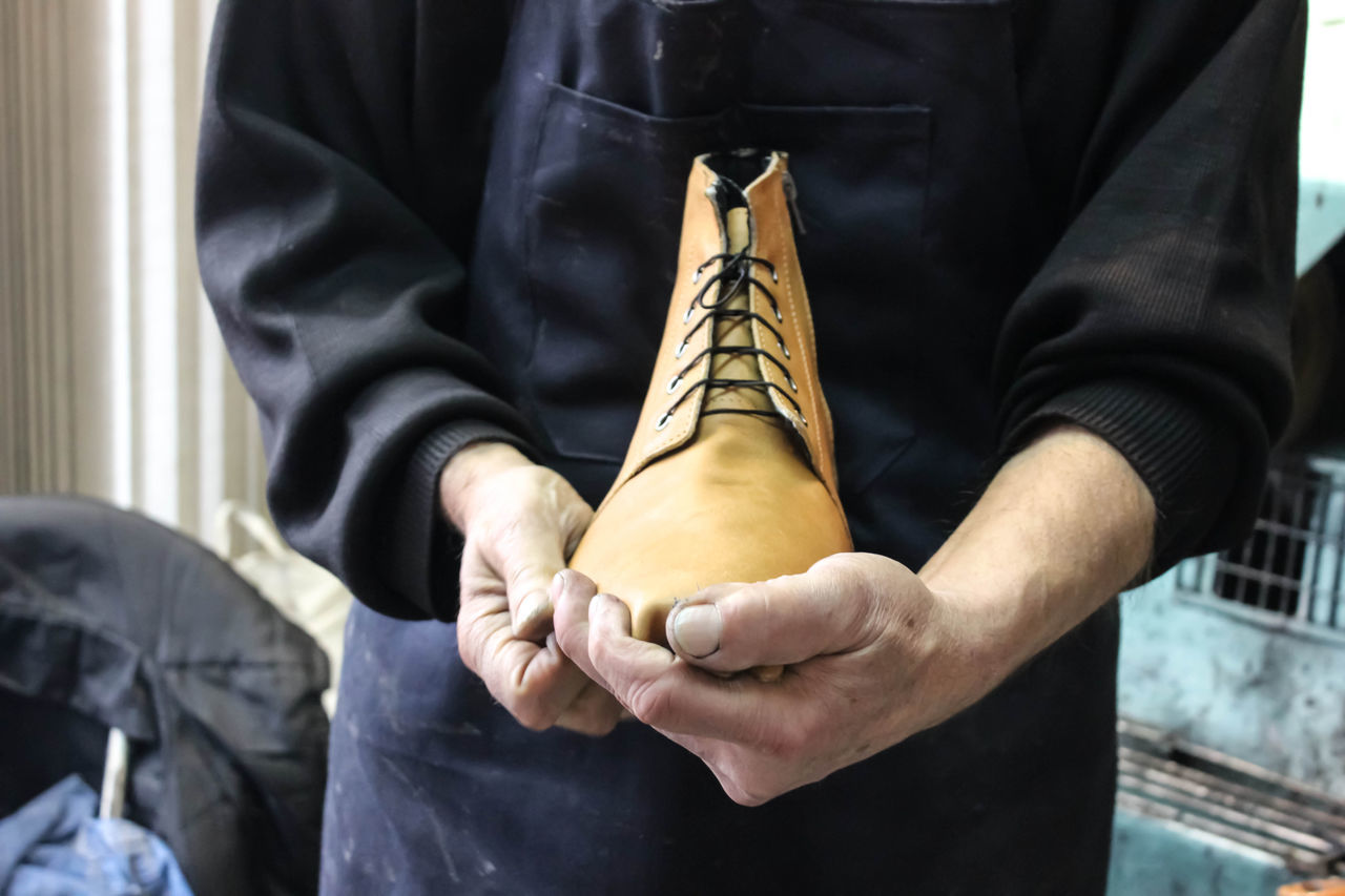 Shoemaker makes shoes Close-up Craft Product Front View Handmade Handmade Shoes Human Body Part Human Hand Indoors  Leather Leather Shoes Manual Work Manual Worker Men Occupation One Person Preparation  Repairing Restoring Shoe Shoemaker Working