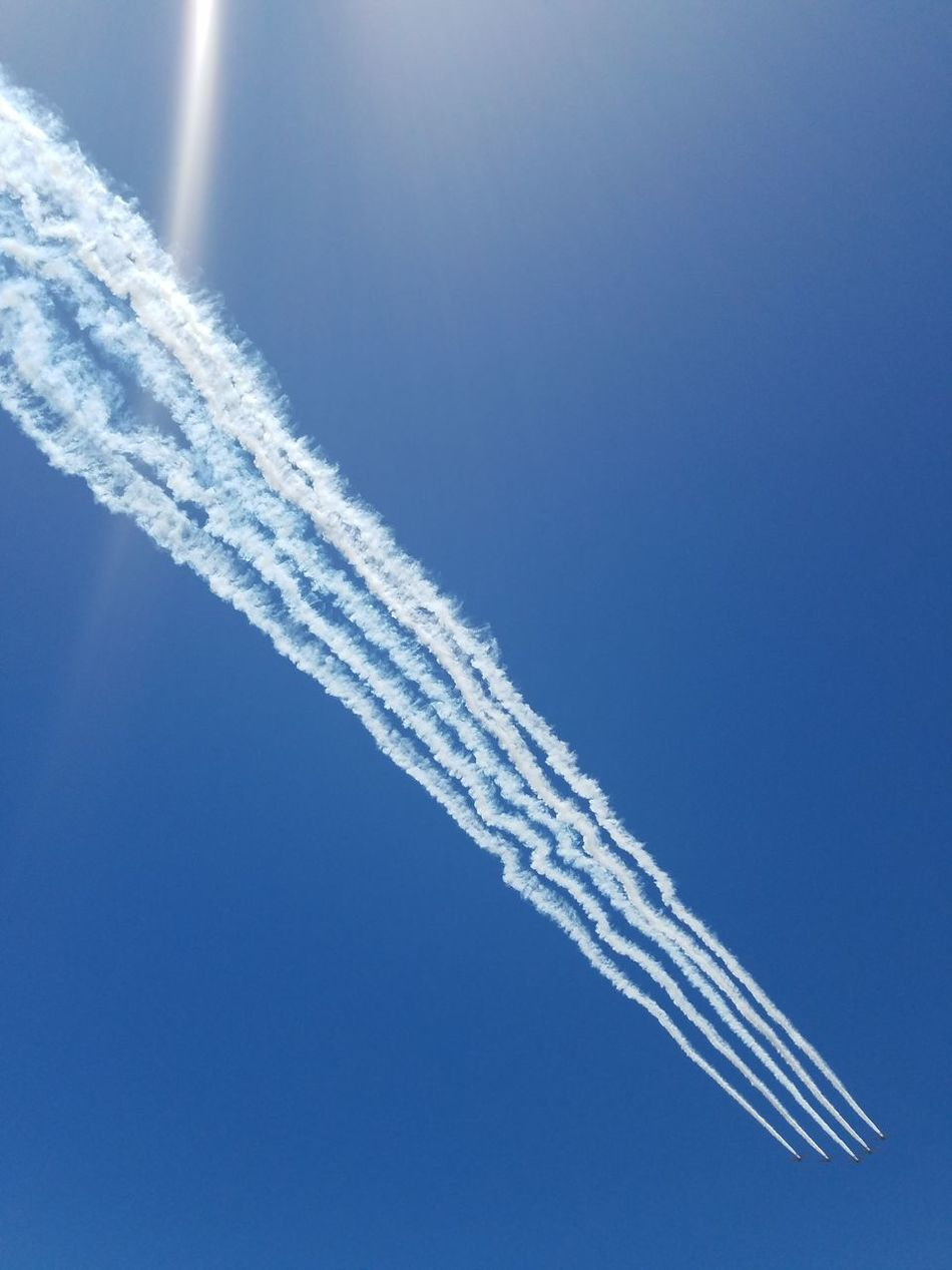 Vapor Trail Blue Flying Air Vehicle Airshow Airplane Sky Clear Sky Transportation Nature Aerospace Industry No People Stunt Day Aerobatics Outdoors Fighter Plane