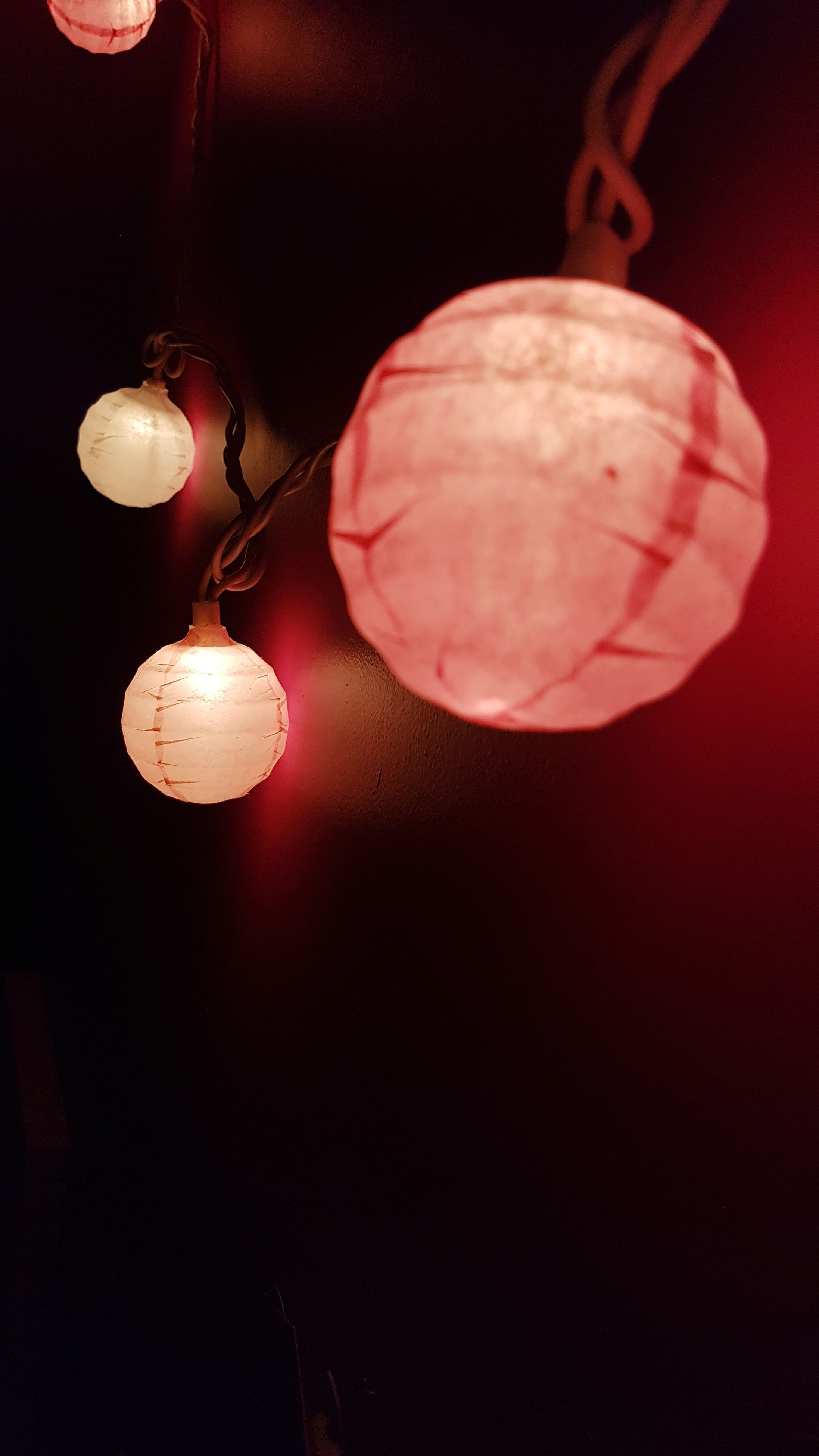 hanging, illuminated, lighting equipment, light bulb, electricity, low angle view, no people, red, indoors, night, filament, close-up