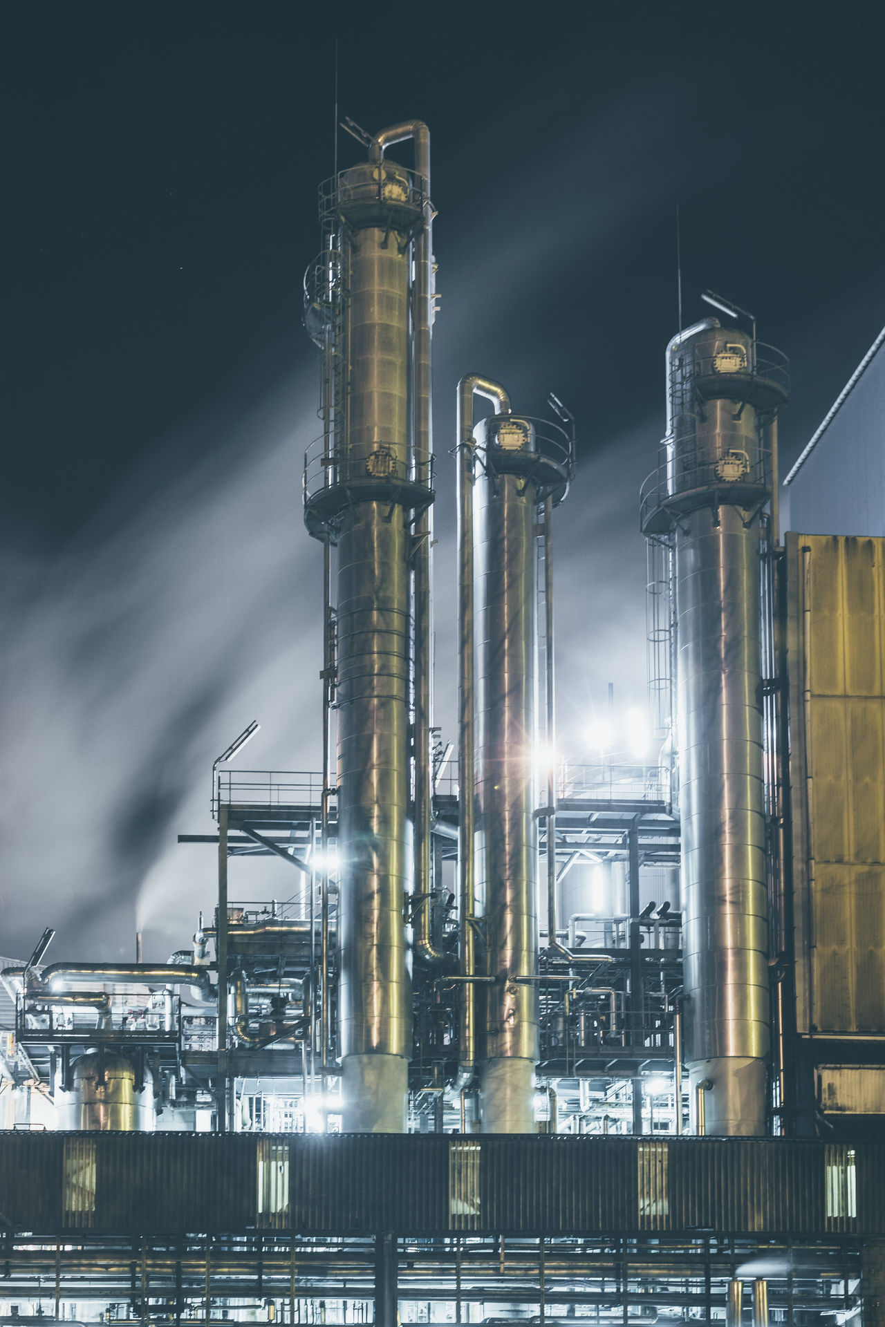 Business Finance And Industry Chemical Plant Distillation Environment Factory Fossil Fuel Fuel And Power Generation Illuminated Industry Metal Night No People Outdoors Pipeline Refinery Refueling Technology