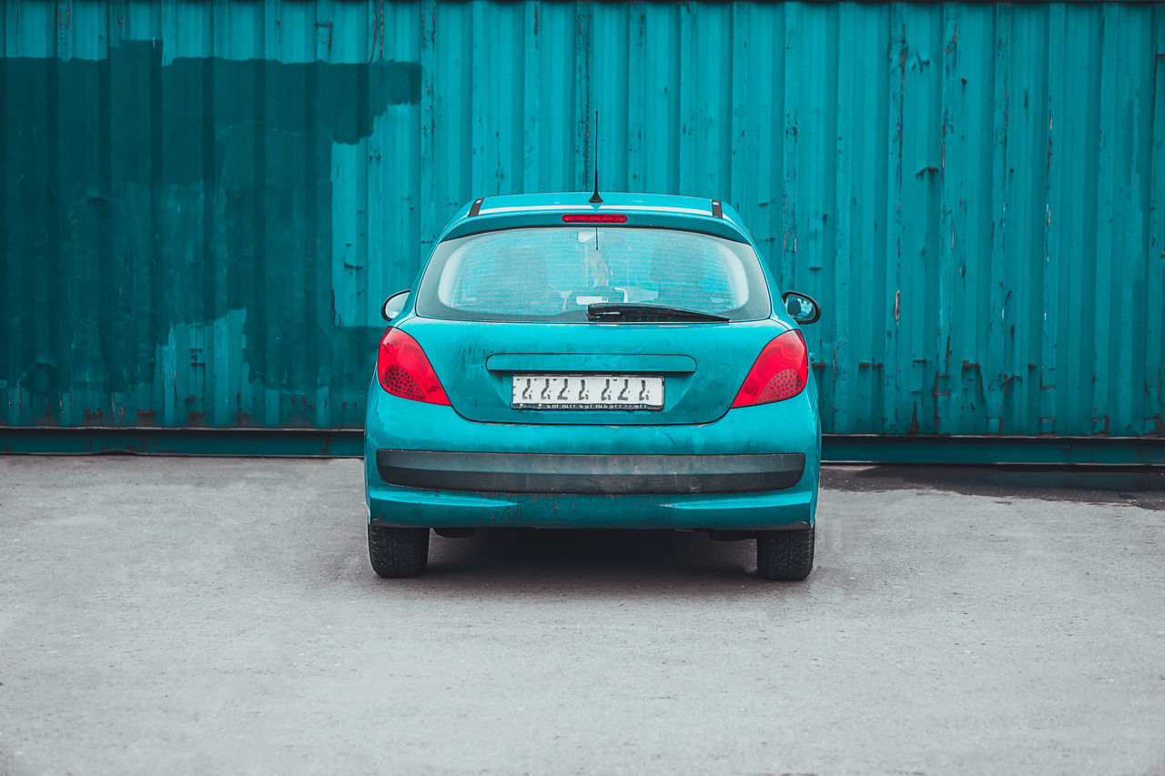 Car Transportation Outdoors No People Day Minimalism Drastic Edit Rear View Taking Photos Colors Parking Concrete Architecture Urban Wall Parked Car Symmetry Symmetrical Blue Abandoned EyeEm Gallery Matching Colors
