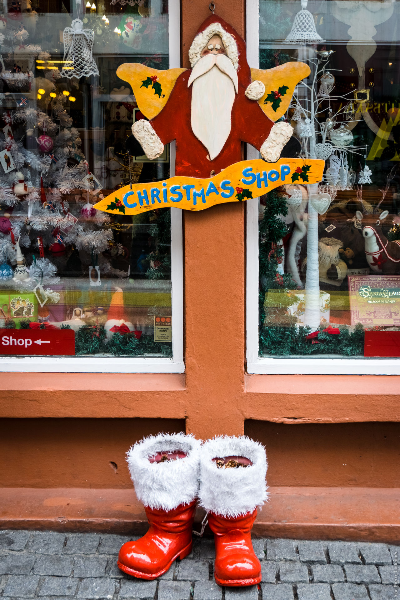 Christmas time is coming Arrangement Boots Choice Christmas Christmastime Communication Creativity Culture Cultures Human Representation Iceland Iceland Memories Iceland_collection Père Noël Santaclaus Shoe Showcase: November Sidewalk Sign Street Text Wall - Building Feature Western Script Window Shopping