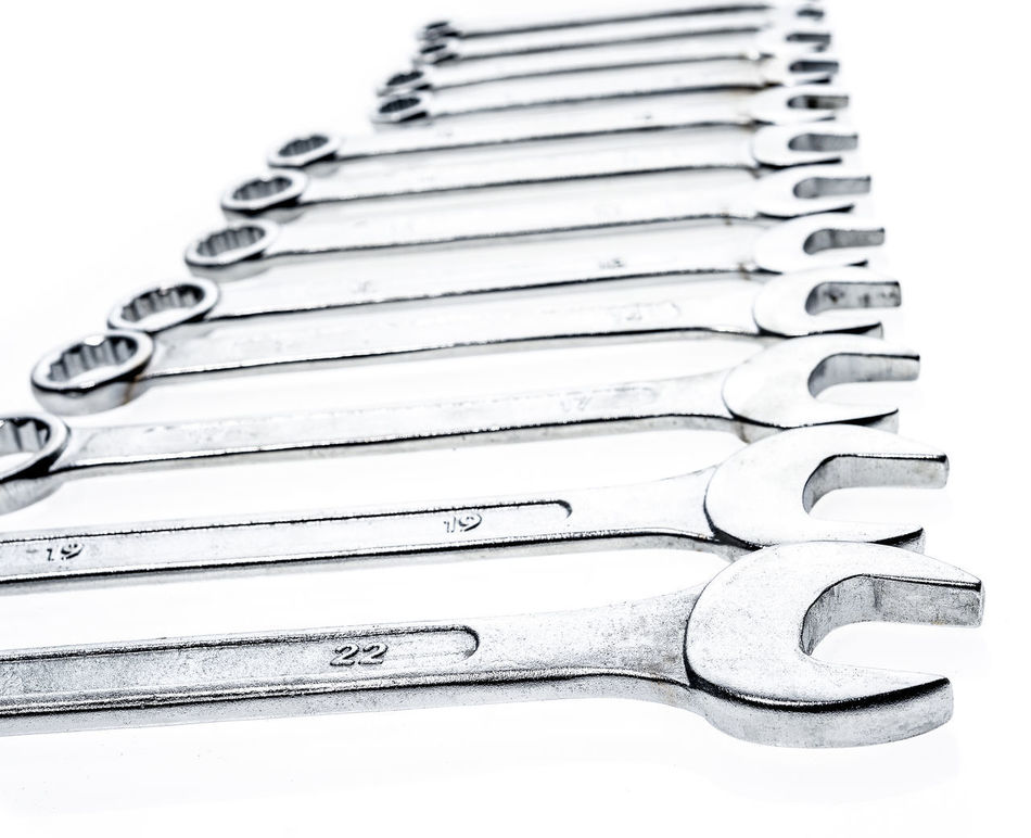 Set of wrenches isolated on white background. Metric set of work tools in a black tool box. Industrial Industry Iron Isolated Metric Set Work Working Chrome Industrial Equipment Metallic Set Of Wrenches Silver  Studio Photography Studio Shot Tool Vanadium White White Background Work Tools Wrench  Wrenches