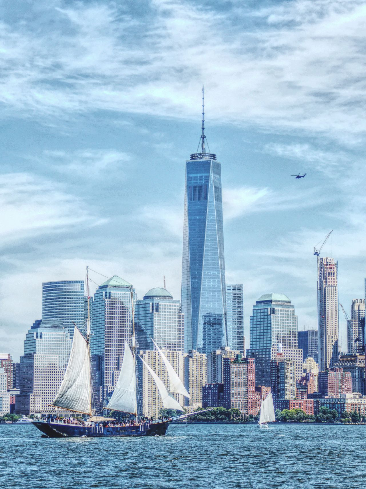 New Filters New York City New York Skyline  Skyscraper Architecture Built Structure Waterfront Water City Tall - High Tower Building Exterior Modern Office Building Travel Destinations Sea Cityscape River Capital Cities  Financial District  International Landmark Tourism Urban Skyline Sailboat Sailing Ship