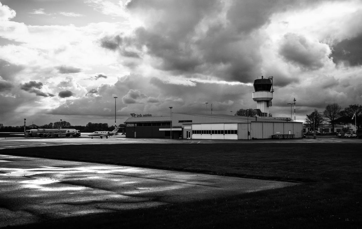 The sky is everything if you photograph outside. It can give a sense of size on what you want to show. (Taken at Groninger airport, Eelde) GH4 Groningen Hanger Netherlands Panasonic  Runway Storm Trees WeekOnEyeEm Airport Blackandwhite Built Structure Cloud - Sky Controltower Day Flare Lumix Nature No People Outdoors Sky Storm Cloud EyeEmNewHere