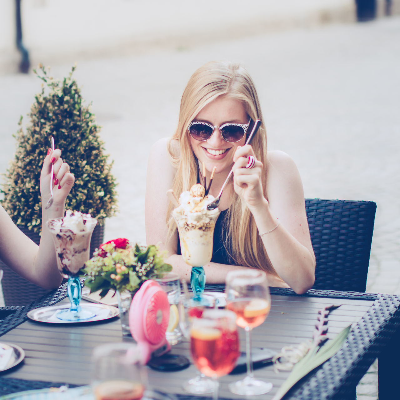 Blond Hair Cafe Day Drink Drinking Friendship Ice Cream Long Hair Only Women Outdoors People Portrait Sitting Smiling Summer Sunglasses Table Young Adult Young Women
